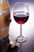 Delicious red wine in wooden barrels. — Stock Photo