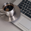 Royalty-Free Stock Photo: The laptop and cup from coffee.