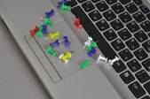 The grey laptop and colour buttons. — Stock Photo