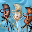 Three masks on blue atlas — Stock Photo #4389144