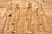 Frescos and hieroglyphs on a wall of the Egyptian temple — Stock Photo