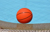 Ball for basketball in pool water — Stock Photo