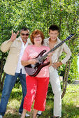 Family on the nature in the summer with an electroguitar — Stock Photo