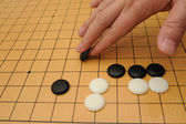 Playing go game — Stock Photo
