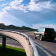 Car moving on elevated road - Stock Photo