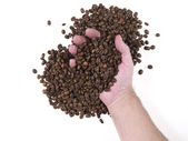 Handful of coffee beans — Stock Photo