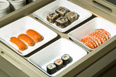 Dish of sushi and sushimi — Stockfoto