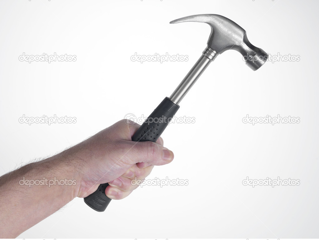 Hand of man that hold hammer on the white background while pounding — Stock Photo #4356515