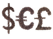 Currency symbols made with a coffee beans — Stock Photo