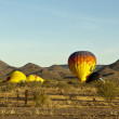 Balloons preparing to lift off in Arizona - Stock Photo