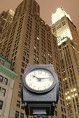 City Clock and Skyscrapers — Stock Photo