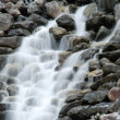 Stock Photo: Cascading waterfall in cloudy day in Norway