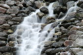 Cascading waterfall in the cloudy day in Norway — Stock Photo