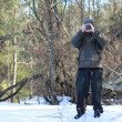 Man photographs in the winter forest — Stock Photo #5177269
