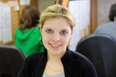 Closeup portrait of a beautiful young blonde girl in the office — Стоковое фото