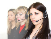 Young beautiful girls telephone operators — Stock Photo
