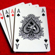 4 aces playing cards on red felt table - Stock Photo