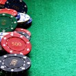 Poker chips on green felt poker table — Stock Photo #4347563