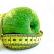 Green apple & measuring tape — Stock Photo
