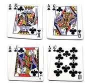 4 top playing card hands — Stock Photo