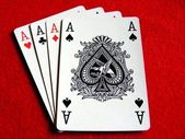 4 aces playing cards on red felt table — Stock Photo