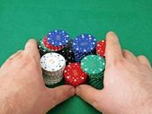 Stack of poker chips being pushed 'all in' — Stock Photo