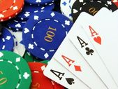 4 Aces on poker chips close up — Stock Photo