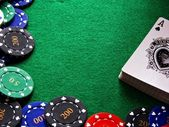 Poker scene - Pack of cards & chips — Stock Photo