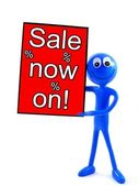 SALE NOW ON sign with blue man — Stock Photo
