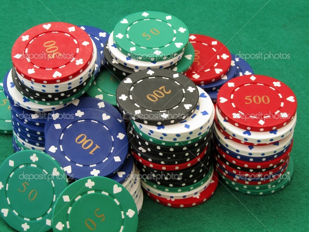 Stack of poker chips on green felt stock photo 169 gcpics