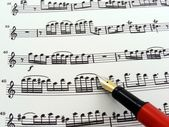 Sheet music with fountain pen — Stock Photo