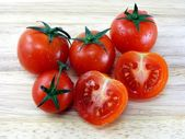 Tomatoes on wooden board — Stock Photo