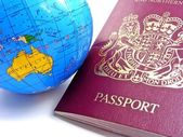 A passport next to a globe - Australia — Stock Photo