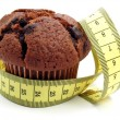Stock Photo: Chocolate muffin & measuring tape