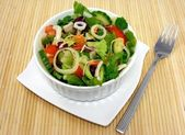 A mixed salad on place mat — Stock Photo