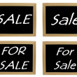 Royalty-Free Stock Photo: 4 x for sale images on blackboard