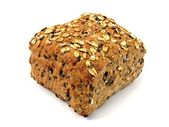A brown bread roll with grains — Stock Photo