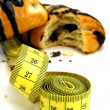 Chocolate pastry cakes & measuring tape — Stock Photo