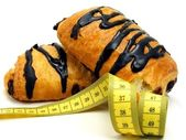 Chocolate pastry cakes & measuring tape — ストック写真