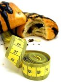 Chocolate pastry cakes & measuring tape — Stock fotografie