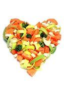 Fresh vegetables in a heart shape — Photo