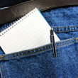 Stock Photo: Workmans note book in back pocket with copy space
