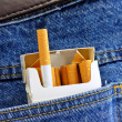 Cigarettes in back pocket — Stock Photo