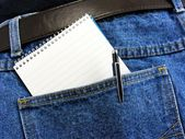 Workmans note book in back pocket with copy space — Stock Photo