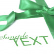 Green bow ribbon — Stock Photo