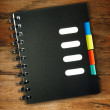 Spiral notebook on a wooden — Stock Photo