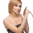 Young woman holding an airbrush pistol in her hands — Stock Photo