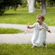 Infant's first steps — Stock Photo