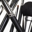 Detail of a random composition with make-up brushes - Stock Photo