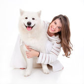 Woman with white dog, smiling — Stok fotoğraf